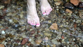 Foot red nail woman girl stand park stream brook water flow stock video