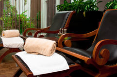 Foot Reflexology Chairs. Two vacant foot reflexology armchair with towels and scented oil stock photography