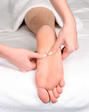 Foot reflexology massage Stock Photos