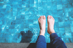 Foot relaxing on the pool Royalty Free Stock Photography