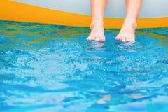 Foot relaxing on the pool. Foot relaxing on the swimming pool Royalty Free Stock Photo