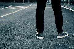 Foot on road backpacking travel. Royalty Free Stock Photography