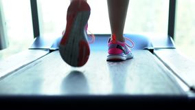 Foot runner on a treadmill, close-up stock footage
