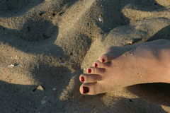 Foot in the sand.  royalty free stock image