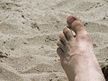 Foot in the sand royalty free stock photos