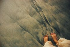 Foot on sand beach royalty free stock image
