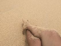 Foot and sand in the beach. Foot with the sand in the beach Stock Photo
