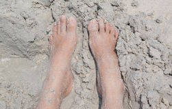 Foot in sand beach Stock Images