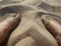 Foot in sand Stock Photography