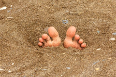 Foot on the sand, summer theme Royalty Free Stock Photos