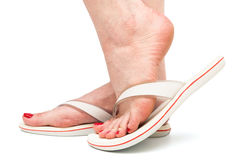 Foot in sandal on white background Royalty Free Stock Photo