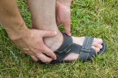 Foot sandals on grass Royalty Free Stock Images