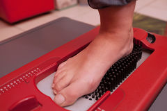 Foot during scanning on device stock photography