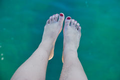 Foot on sea Stock Images