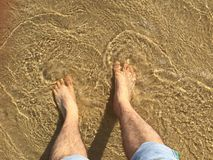 Foot in the sea water Royalty Free Stock Image