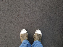 Foot selfie or feet in canvas shoes standing on asphalt Royalty Free Stock Photo