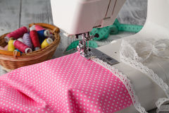 Foot of sewing machine with polkadot clothes