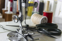 Foot sewing machine with scissors and spools Royalty Free Stock Images