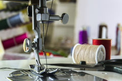 Foot sewing machine with thread inserted on the needle Royalty Free Stock Image
