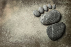 Foot shape by stone Royalty Free Stock Images