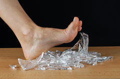 Foot and shards. Bare foot over a pile of shards Stock Photos