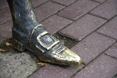 Foot in the shoe statue. Stock Images