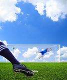 Foot shooting soccer ball to goal. Penalty Stock Image