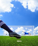 Foot shooting soccer ball to goal Stock Photo