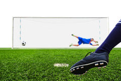 Foot shooting soccer ball to goal Stock Photos