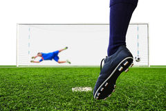 Foot shooting soccer ball to goal Royalty Free Stock Photo