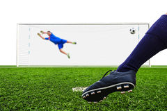 Foot shooting soccer ball to goal Royalty Free Stock Image