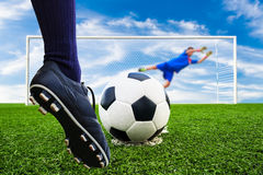 Foot shooting soccer ball to goal Royalty Free Stock Images