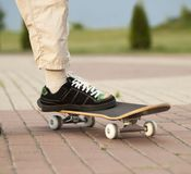 Foot on the skateboard royalty free stock photography