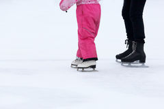 Foot skating girls and women on an ice rink Stock Photo