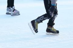 Foot skating people on the ice rink royalty free stock photo
