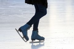 Foot skating people on the ice rink
