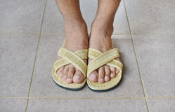 Foot in slippers weave Royalty Free Stock Images