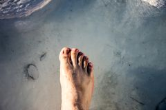 Foot in the small waterpool with thermal water. For enjoiying and medical therapy Stock Photography