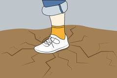 Foot in a sneaker Stock Image