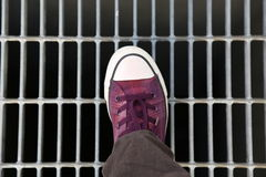 Foot sneaker stepping latticework. Background youth foot wear bars Royalty Free Stock Photo
