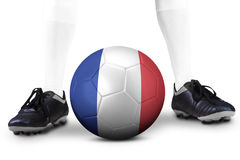 Foot and soccer ball with a France flag Royalty Free Stock Photos