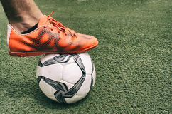 Foot and soccer ball Stock Photos