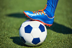 Foot of soccer player in football boot on ball Stock Photo