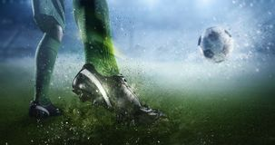 Soccer goal moment. Mixed media. Foot of soccer player kicking ball. Mixed media Stock Image