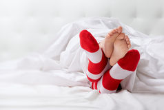 Foot in the socks Royalty Free Stock Photo