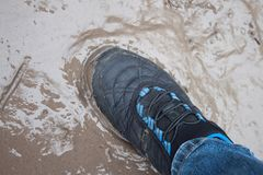 Foot in soft mud puddle stock photos