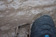 Foot in soft mud puddle Royalty Free Stock Photos