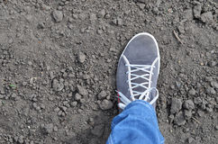Foot on soil background Royalty Free Stock Images