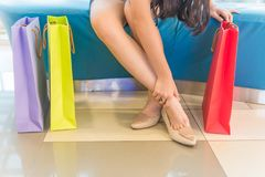 Foot soreness and inflammation. Caused by wearing high heels shoes stock photos