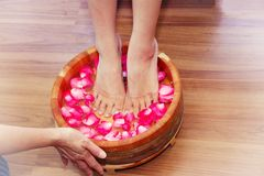 Foot spa. Treatment for massaging feet Royalty Free Stock Photo